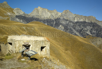 Military ruin and Les Roubines negres  seen from the forks pass (2261m)  Haute Tinee Valley in autumn  Mercantour  Alpes  France