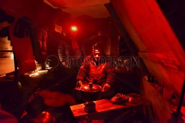Explorers in a small hut in Greenland  February 2016  The red light doesn't dazzle them