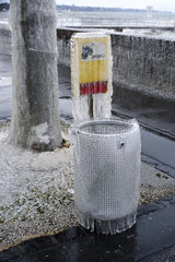 Waste bin frozen during the episode of extreme cold around Lake Geneva  January 17  2017  Versoix  Switzerland