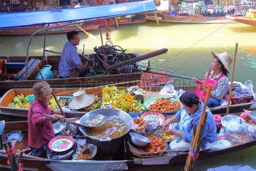Traders in their boats discussing floating market in Damnoen Saduak near Bangkok  Thailand