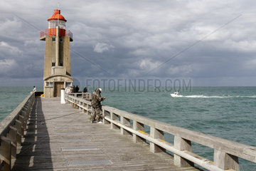 Anglers on the pier of Fecamp lighthouse  Normandy  France