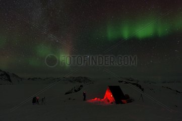 Small hut in Lillefjord  Under aurora borealis  Greenland  February 2016
