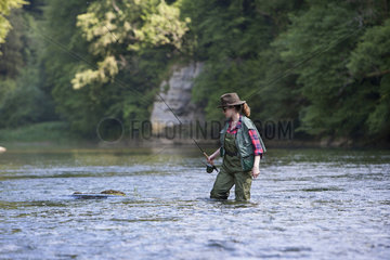 Young Woman  Fly fishermen on the French-Swiss Doubs river  La Goule  Franche-Comte  France