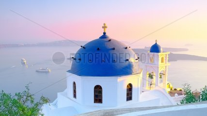 Sunset on the chapel of Imerovigli  village located 2 KM from Fira at overlooking the caldera. Santorini  Cyclades  Greece