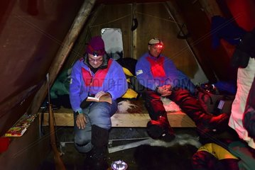 Inside the hut  18 hours of pitch-dark night  explorers have to keep themselves busy  Greenland  February 2016