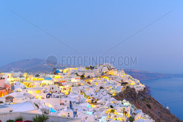 View over the village Fira  administrative capital of the island of Santorini built on the caldera at dusk  Cyclades  Greece.