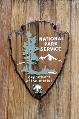 National Park Service Arrowhead in Yellowstone National Park  Wyoming  USA