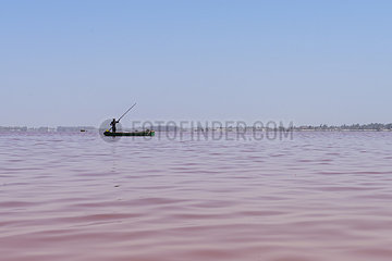 Salt collector in his canoe - Pink Lake Senegal