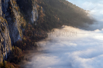 Sea of clouds over an alpine valley in autumn. Haute-Savoie  France.