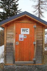 Pit toilet in ski resort  Savoie  Alps  France