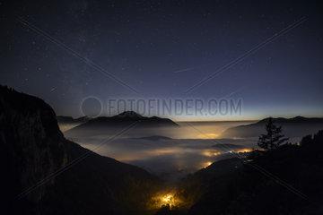 Stratus cloud lit by alpine villages  France