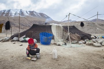 Boy washing his hands in an encampment  Surroundings of Korzok  Leh  Ladakh  Himalayas  India