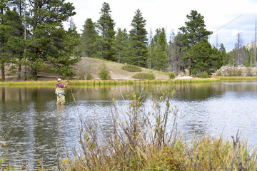 Fly-fisherman in a lake in Colorado  USA
