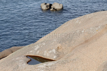Figure in the shape of a heart dug by nature in a rock of the Pink Granite Coast   Ploumanac'h  Brittany  France
