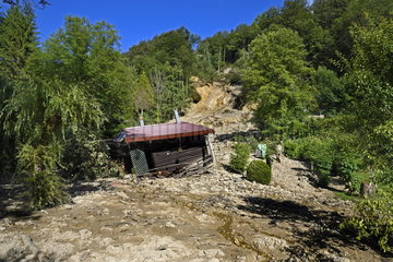 Collapse cliff and mudslide on the departmental road  chalet washed away by the torrent of materials  Soulce cernay  Franche-Comte  France