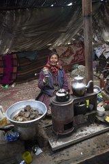 Woman with prayer wheel inside a Yack wool tent  Surroundings of Korzok  Leh  Ladakh  Himalayas  India