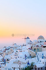 Sunset over the village of Oia  Santorini Island  Cyclades  Greece