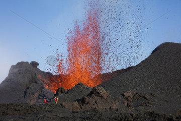 Volcanologist on Piton de la Fournaise in activity  Volcano eruption 16 of september 2016  Reunion