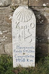 Milepost near the lighthouse St Mathieu announcing the distance between the Pointe Saint-Mathieu and St. Jacques de Compostella  Brittany  France