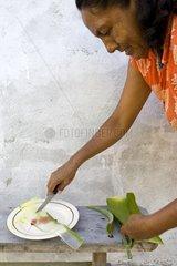 A woman prepares a piece of aloe vera Isabela Island