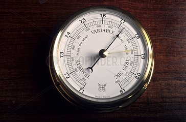 Barometer hung on panelling in studio
