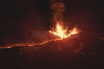 Photographer on Piton de la Fournaise in activity  Volcano eruption 13 of september 2016  Reunion