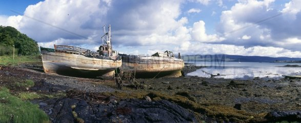 Wrecks at low tide under a stormy sky Mull island Scotland