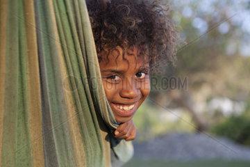 Portrait of girl in a hammock - Tanna Island Vanuatu
