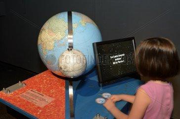 Girl visiting the 2015 exhibition Lights on the Moon   Pavillon des Sciences   Parc du Près- la-Rose Montbeliard  Franche-Comte  France