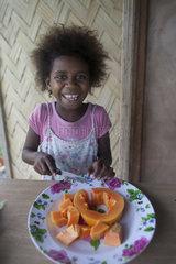 Girl preparing papaya jam - Tanna island Vanuatu