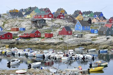 Denmark. Greenland. West coast. The village of Aasiaat and its colorfull houses.