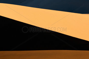 Contrasts of light in the sand of the Namib Desert in backlight  Namibia