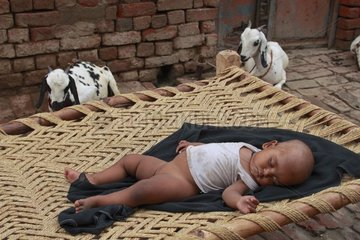 Girl doing a nap in an street Inde