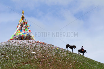 Rider and stupa at the Lapsté - Tibet China