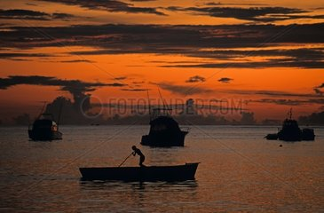 Fisherman coming back from a day of fishing in Mauritius