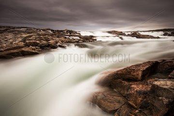 Blurred image of rushing waterfall near Bury Cove along west coast of Hudson Bay (Barren Coastline) 100 miles south of the Arctic Circle  Nunavut Territory  Canada