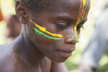 Makeup of a boy in color of the flag of Vanuatu