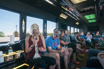 Smoking marijuana on a cannabis bus tour. Denver  CO  USA