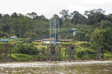 Coal loading conveyor on the Mahakam river bank - Indonesia