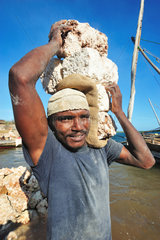 Loading of blocks of coral in a dhow - Lamu Kenya