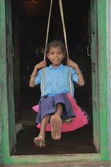 Filllette swinging on a swing of fortune India