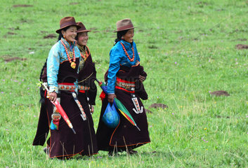 Women in traditional dress during Lapste - Tibet China
