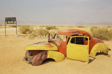Scrapped cars are displayed at the hamlet of Solitaire between Sawakopmund and Sesriem at the edge of the Namib Desert  Namibia.