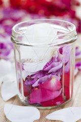 Jam jar filled with multicolor Rose petals France