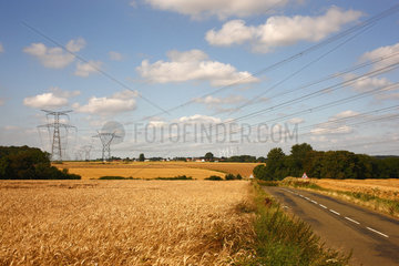 Pylons and high-voltage lines crossing the countryside of the Oise  Picardy  France.