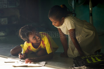 Children doing homework - Grogos Island Maluku Indonesia