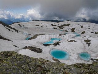 Thawing high mountains lake  Lac noir  Haute-Savoie (74)  Aiguilles Rouge National Nature Reserve  Alps  France