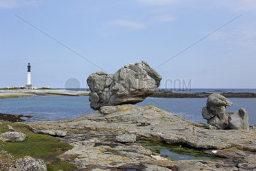 Lighthouse on the island of Sein and rocks - France Bretagne