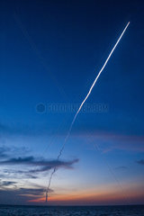 Launch of the Ariane rocket seen from the ocean off French Guiana