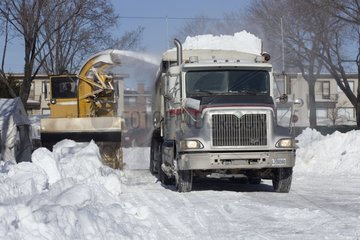 Snow removal machinery in action after a snow storm Quebec